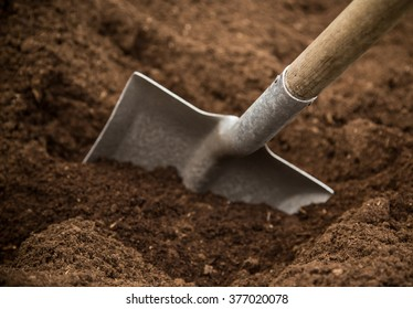 Shovel in the ground, close-up.