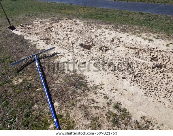 shovel and rake in the sand