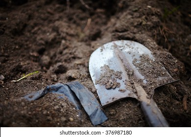 Shovel spoon - tool for digging soil for planting gardening tools and peat on brown background Spade or digging tool