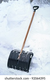 Shovel in a very high snow on winter days