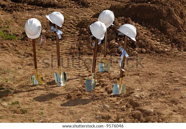 Shovels and hardhats at a groundbreaking
