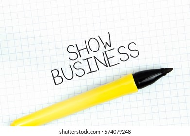 SHOW BUSINESS concept write text on notebook