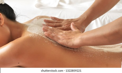 Show Hands moving blur of masseuse while body scrub. Salt Scrub Beauty Treatment in the Health Spa.