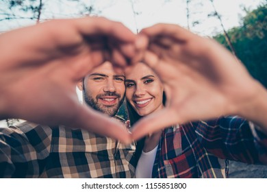 Show happiness gentle emotion friendship honeymoon concept. Close up view photo portrait of two beautiful lovely sweetheart guy and lady shooting self selfie making heart looking at camera