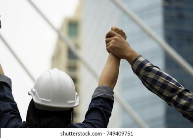 Show his hand for winning or success  the project. Show hands up for the winner outdoor background .