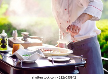 Show Kitchen. The cook prepares Carpaccio Family for the guests of the restaurant.