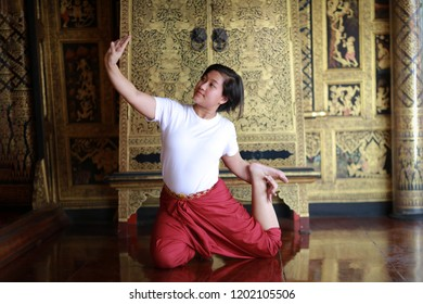 show practice of Thai dancing art with traditional student dress , Classical Dance in white shirt red loincloth