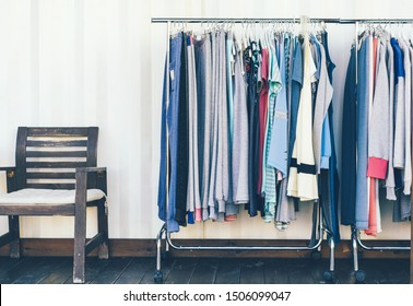 Show room with clothes. Textiles hang on a hanger for selection and fitting.
