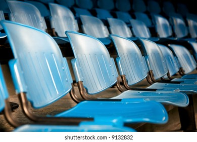 the show: rows of blue plastic chairs