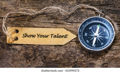 Show Your Talent - Motivation tips handwriting on label with compass