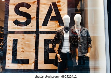 Showcase clothing store with sale sign