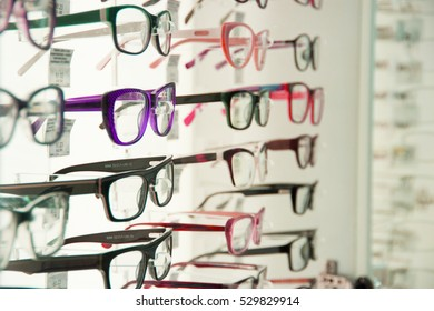 showcase with different spectacles, glasses, eyeglasses, specs