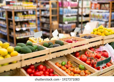 Showcase with fresh organic vegetables and fruits in supermarket