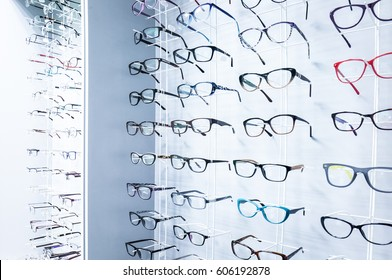Showcase with glasses in modern optic store
