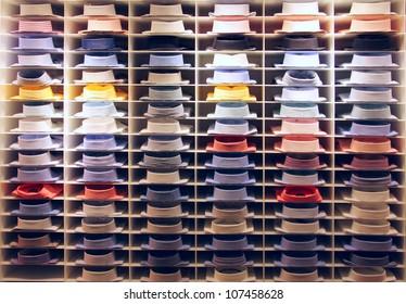 Showcase with many colorful shirts on shelfs