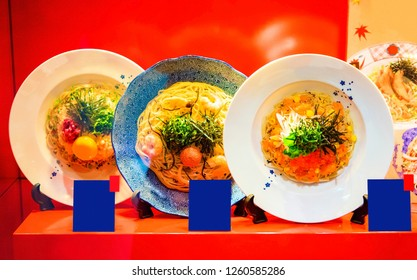 Showcase restaurant with mock up dishes. Dishes in the restaurant with signs, Tokyo, Japan. Close-up