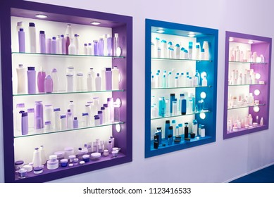 Showcase shop with plastic bottles and jars cosmetic and shampoo