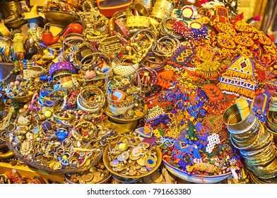 The showcase of the stall in Vakil Bazaar with heap of jewelries - rings, bracelets and beads, Shiraz, Iran.