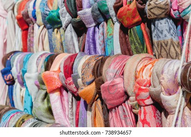 Showcase street of minimarket women's colorful scarves . The horizontal frame.