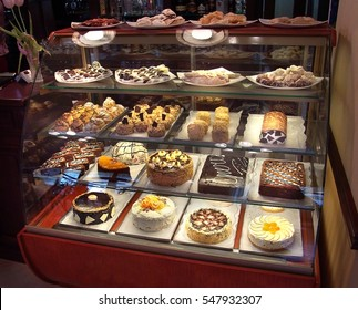 Showcase with sweets. Cakes, pastries, biscuits.