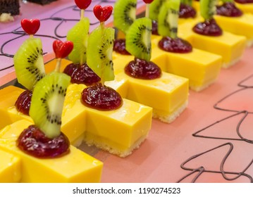 Showcase with sweets. Sweets with fruits in the restaurant.