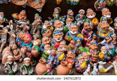 the showcase with Uzbek Souvenirs, ceramic figurines of people