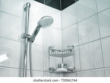 Shower cabin in a bathroom. Water stream flowing. Drops on the transparent glass door