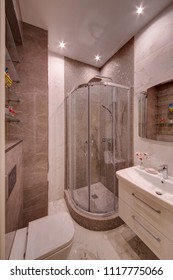 A shower cabin with glass doors in the light room