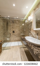 Shower cabin and wash basin in bathroom interior