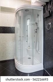 Shower cabine standing in black corner