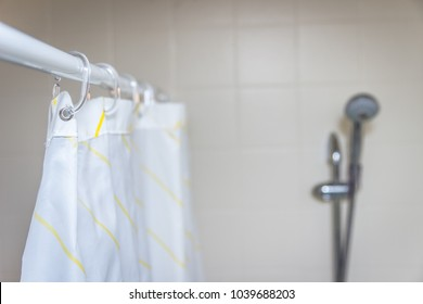 Shower curtain with blurred shower head in background