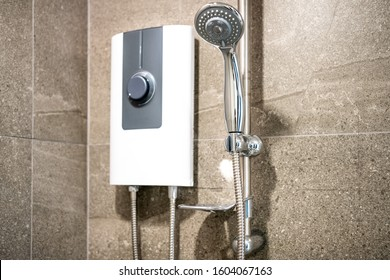 Shower and electric water heater in the bathroom