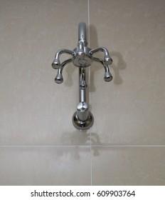 A shower head in a bathroom