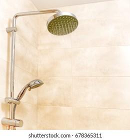 Shower head in the bathroom with running water