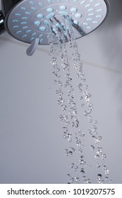 Shower head and flowing water.