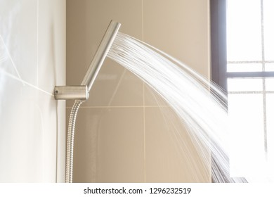 Shower Head and Shower Hose stainless steel push smooth water flow near window sunlight