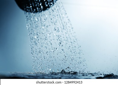 Shower head and water drops.