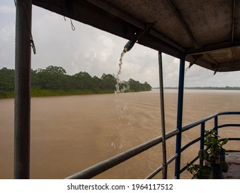 Shower on a cargo ship sailing from Santa Rosa to Iquitos. Peru. Amazonia. Latin America