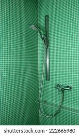 shower on green mosaic tile wall in contemporary bathroom