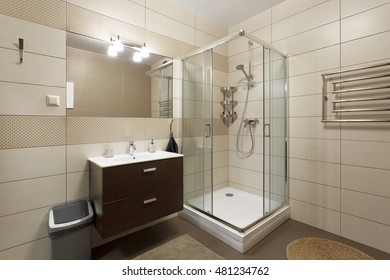 Shower and sink built into the corner of the bathroom. Interior design