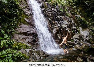 shower under a waterfall in the jungle/ MANU national-park, peru, south america
