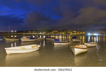 Showing the boats at Shaldon waterfront during a long exposure on a dark night.