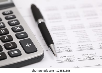 Showing business and financial with calculator and pen on book