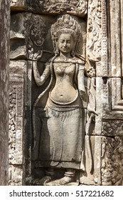 showing dancing Hindu goddesses at Bayon temple, Cambodia.
