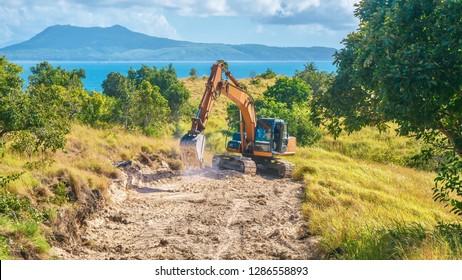 Showing environmental damage created by the tourist industry, as a new public road is being constructed to provide access to develop virgin land for tourism in the Philippines.