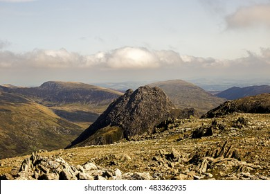 Showing the Gylder Fach high up on Snowdonia moutain range in Wales with Snowdon and Tryfan in the background. Emphasising exploration and traveling, backpacking and hiking in the outdoor world.