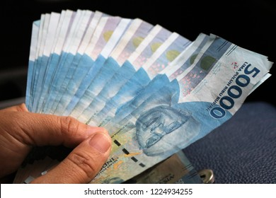 Showing Indonesian rupiah worth 50,000