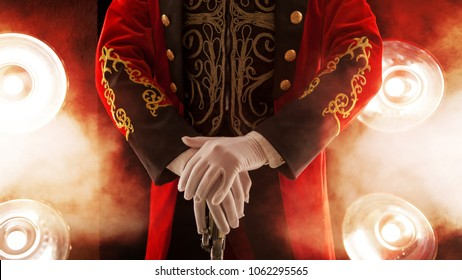 Showman. Pose, hands rest on stick. White gloves and beautiful sleeve of his coat, smoke on background of the spotlight