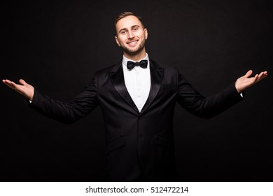 The showman in suit over black background. Showman concept.