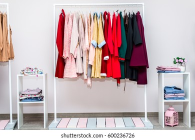 Showroom interior. Female casual clothes on the hanger rack. The modern concept of fashion, shopping, sale, clothes. Front view of the hanger with clothes.